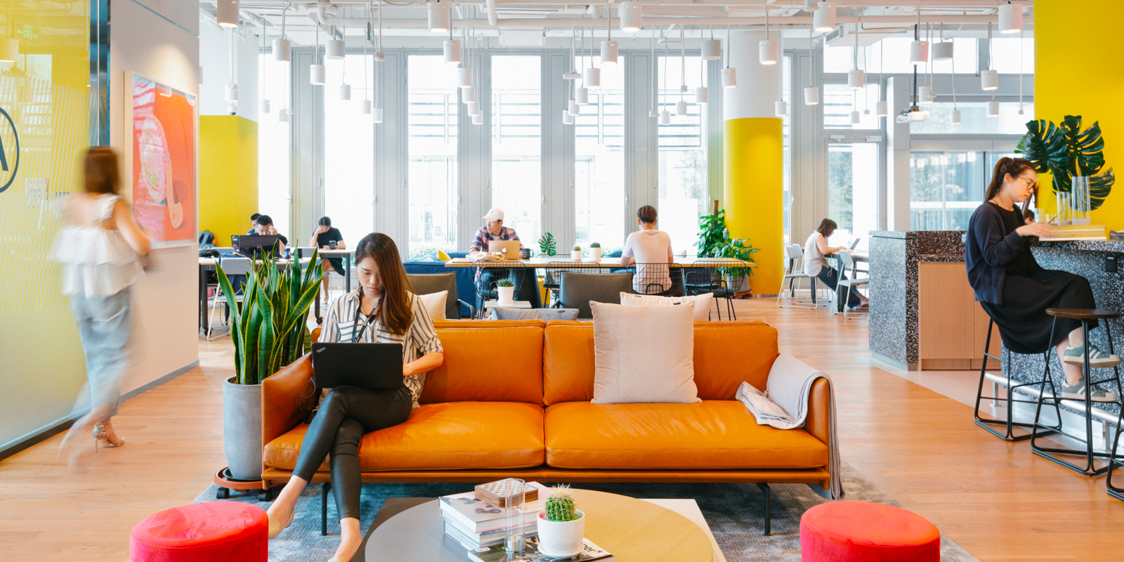 People working in a wework space