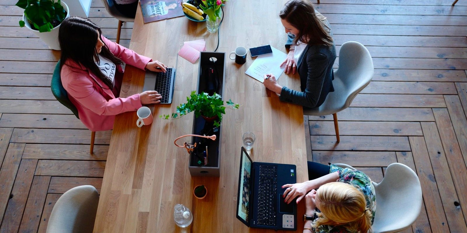 Coworking space members working at a table